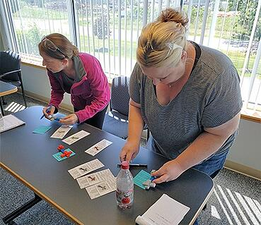 Becky and Kari checking quality during a Lean training exercise at MCL.